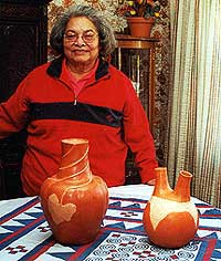 Anna Mitchell displays a wedding vessel, right, and relief melon pot.